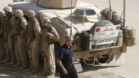 FILE PHOTO: US President George W. Bush makes unannounced visit to Al-Asad Air Base in Iraq, September 3, 2007