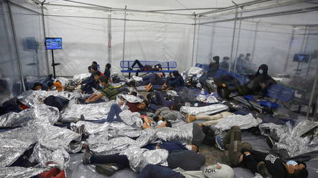 Migrants crowded inside the US Customs and Border Protection detention facility in Donna, Texas, March 30, 2021.