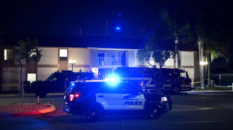 Police officers stand outside a building were multiple people were killed in a shooting in Orange, California on March 31, 2021