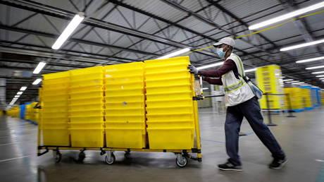 An employee works inside Amazon's JFK8 distribution center in Staten Island, New York, U.S. November 25, 2020.