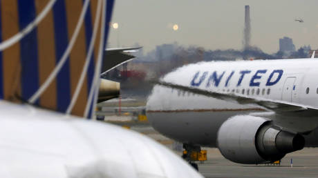 FILE PHOTO: A United Airlines passenger jet taxis at Newark Liberty International Airport, New Jersey, U.S. December 6, 2019.