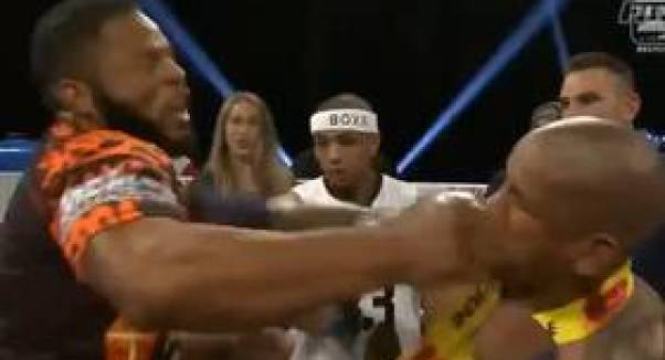 Hector Lombard appearing to trade blows with BKFC fighter, Lorenzo Hunt.