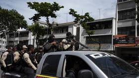 3 reported dead in Caracas gun battles as Venezuelan police fight gangs seeking to expand territory (VIDEOS)