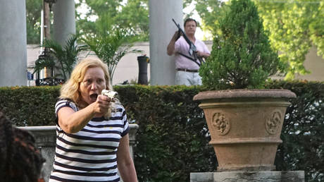FILE PHOTO: Patricia and Mark McCloskey draw guns on protesters outside their home during a demonstration against St. Louis Mayor Lyda Krewson, in St. Louis, Missouri, June 28, 2020.