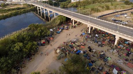 Migrants, many from Haiti, are seen at an encampment along the Del Rio International Bridge near the Rio Grande in Texas