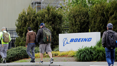 FILE PHOTO: Workers head into a Boeing factory in Renton, Washington, April 21, 2020.