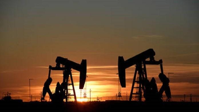 Oil rises a dollar, thanks to talks
