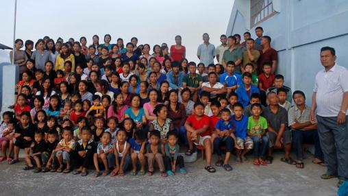 Family members of Ziona (R) poses for group photograph outside their residence in Baktawng village in the northeastern Indian state of Mizoram, on October 7, 2011.