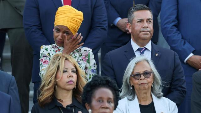 Rep Ilhan Omar wipes her tears as members of Congress observe a moment of silence for the 600,000 American lives lost to Covid-19, outside US Capitol in Washington, DC, on June 14, 2021.
