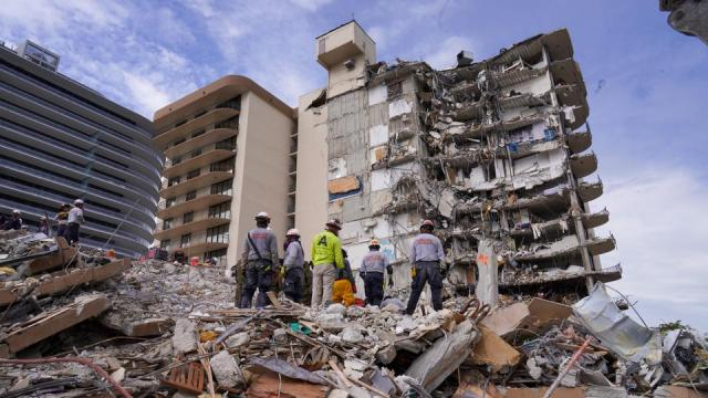 Search and rescue personnel work at the site of a collapsed Florida condominium complex in Surfside, Miami, US, in this handout image July 2, 2021.
