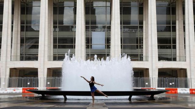 Dancer Sabrina Olivieri dances in front of the Revson Fountain in the Lincoln Center, home to the Metropolitan Opera House and New York City Ballet, in New York City on September 26, 2020.