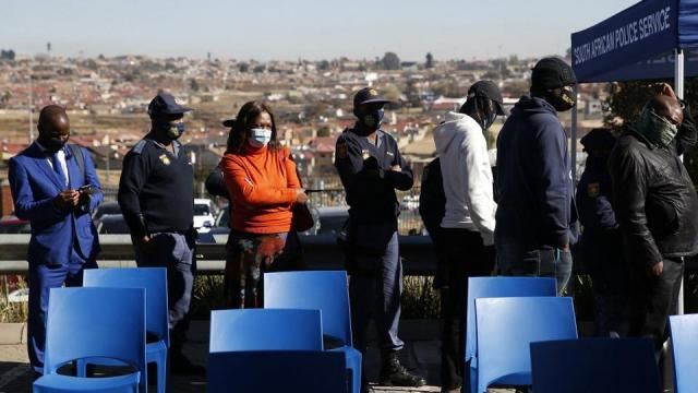 Members of the South African Police Services queue to receive their dose of the Johnson and Johnson vaccine in Soweto on July 5, 2021.