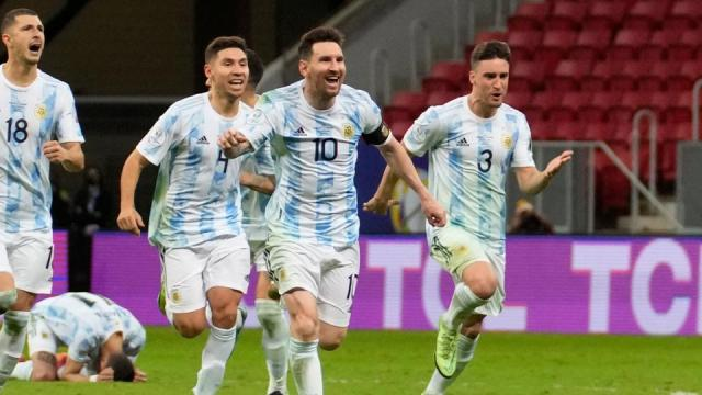 Argentina's Lionel Messi (10) and teammates celebrate defeating Colombia in a penalty shootout during a Copa America semifinal soccer match at the National stadium in Brasilia, Brazil, Wednesday, July 7, 202