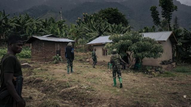 Soldiers patrol the village of Mwenda, attacked by ADF rebels, in northeastern Democratic Republic of Congo, on May 23, 2021.