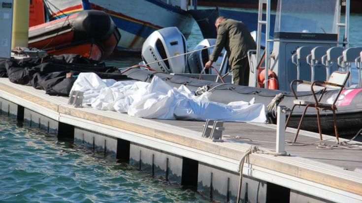 Bodies of victims are seen after a fishing boat carrying 40 African migrants capsized near the shores of Sfax, Tunisia on December 24, 2020.