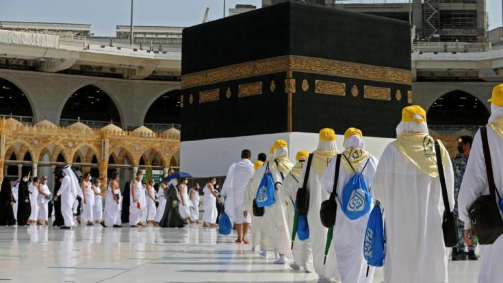 Pilgrims arrive at the Kaaba at the Grand mosque in the holy city of Mecca, at the start of the Hajj season, on July 17, 2021.