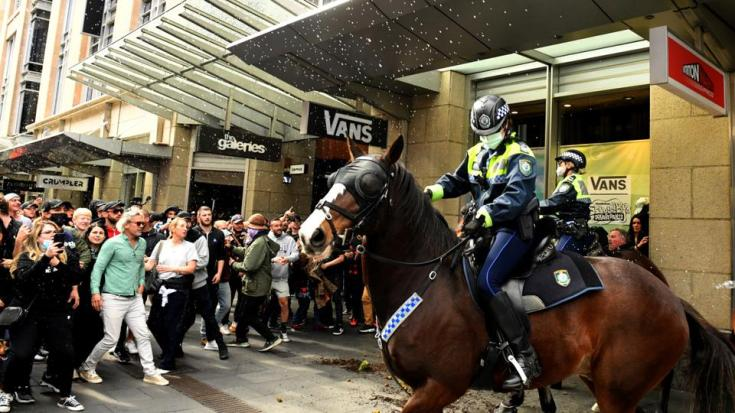 Protesters clash with police during an anti-lockdown rally in Sydney, Australia, on July 24, 2021.
