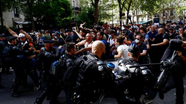 French riot mobile gendarmes face protesters during a demonstration in Paris on July 24, 2021.