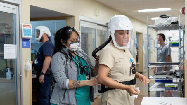 Healthcare personnel work in Covid-19 intensive care unit where they are dealing with a surge in cases of the Delta variant at Intermountain Medical Center in Murray, Utah, US.