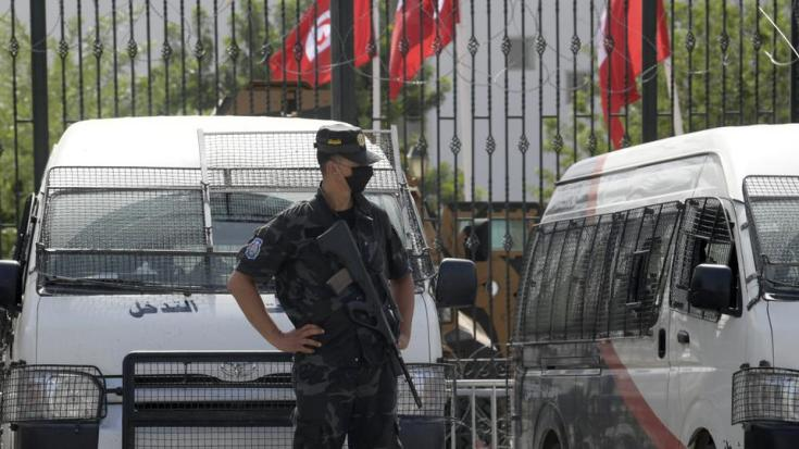Tunisian police stand guard outside the parliament in Tunis on July 27, 2021.