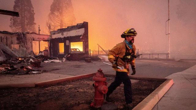 A firefighter battles the Dixie Fire as it tears through the Greenville community in Plumas County, Calif., Wednesday, August 4, 2021.
