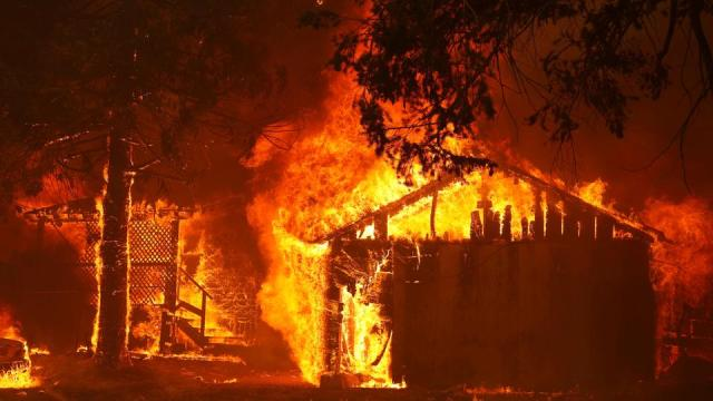 A house is fully engulfed by flames at the Dixie Fire, a wildfire near the town of Greenville, California, US, August 5, 2021.