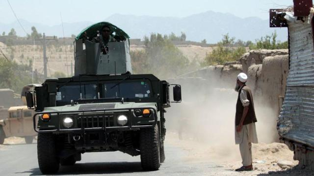 Afghan National Army (ANA) soldiers patrol the area near a checkpoint recaptured from the Taliban, in the Alishing district of Laghman province, Afghanistan on July 8, 2021