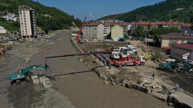An aerial view of pontoon bridge being built up over the Ezine stream after the deadly flash floods in Bozkurt district of Kastamonu, Turkey on August 15, 2021