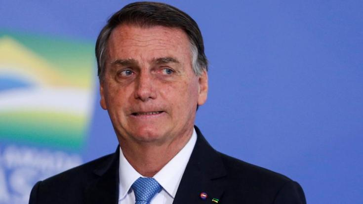 Brazil's President Jair Bolsonaro looks on during a promotion ceremony for generals of the armed forces, at the Planalto Palace in Brasilia, Brazil, August 12, 2021
