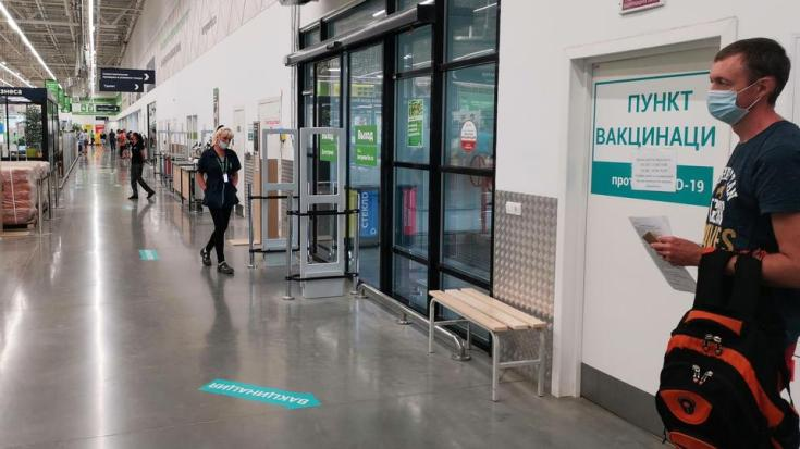 A man waits outside a vaccination point for recipients of the coronavirus vaccine opened at a Leroy Merlin hardware store in Belgorod, Russia on August 10, 2021.