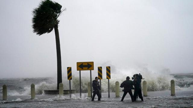 A news crew reports on the edge of Lake Pontchartrain ahead of approaching Hurricane Ida in New Orleans, August 29, 2021.