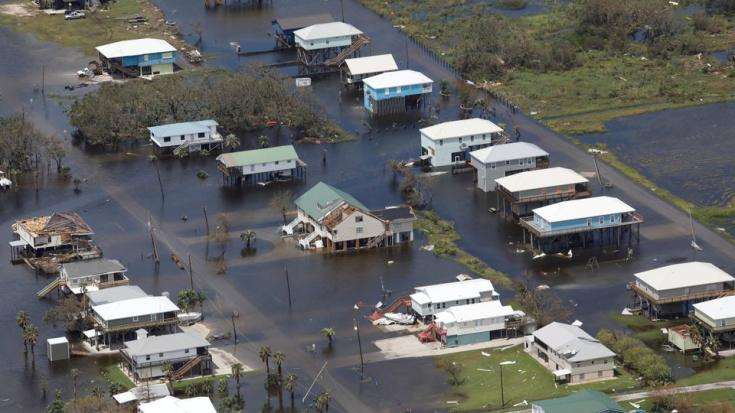 An aerial view shows destroyed houses in a flooded area after Hurricane Ida made landfall in Louisiana, in Grand Isle, Louisiana, US on August 31, 2021.