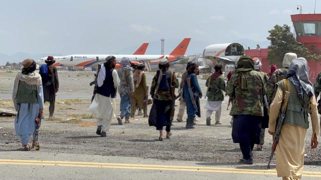 Taliban forces patrol at a runway a day after US troops' complete withdrawal from Kabul airport in Afghanistan, on August 31, 2021.