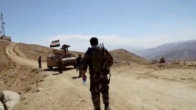 A humvee with National Resistance Front flag is seen in front of a radio mast near Panjshir Valley, Afghanistan in this still image obtained from an undated video handout.