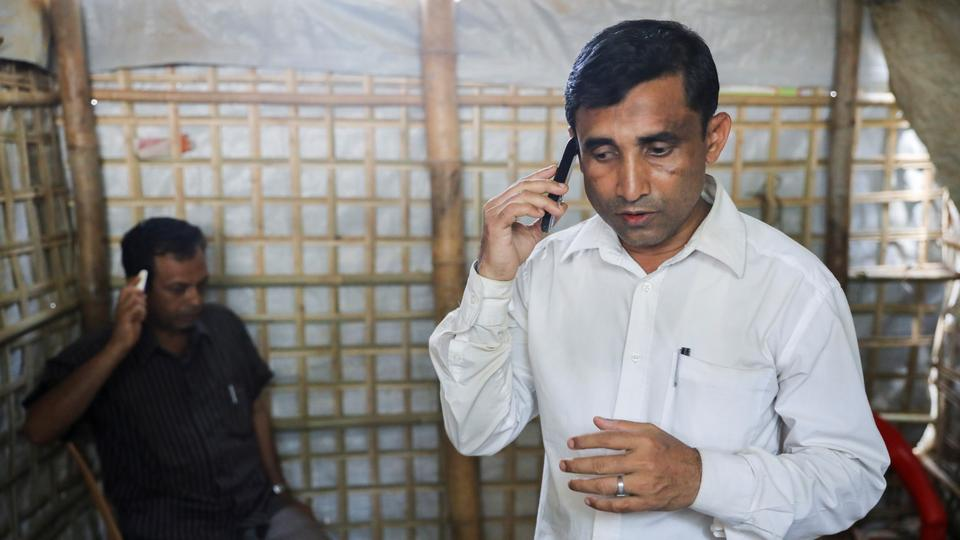 Mohib Ullah, a Rohingya Muslim leader from the Arakan Rohingya Society for Peace and Human Rights, speaks on a phone at his residence in Kutupalong refugee camp in Ukhiya, Cox's Bazar, Bangladesh, April 21, 2018.