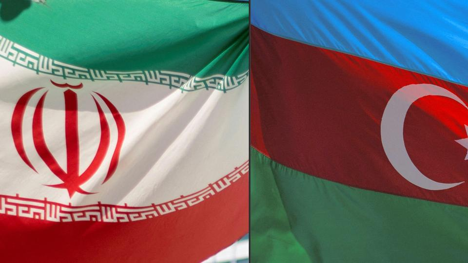 The combination of pictures shows (L to R) an Iranian and Azerbaijani flag.