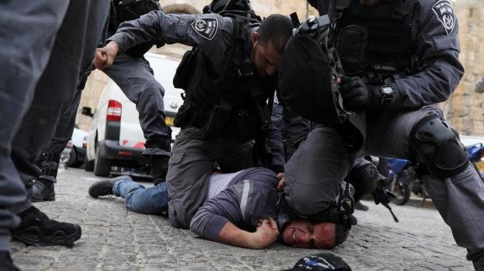 Israeli police officers detain a Palestinian protestor during scuffles outside the compound housing al Aqsa Mosque in Jerusalem's Old City March 12, 2019.