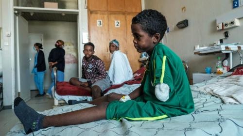 Fisseha Abraha, 8-years-old, sits on his bed at the Ayder Referral Hospital in the Tigray capital Mekele on February 25, 2021, after being injured during fighting between the Tigray People's Liberation Front which fell after Ethiopian Prime Minister deployed troops and warplanes to oust the TPLF late last year