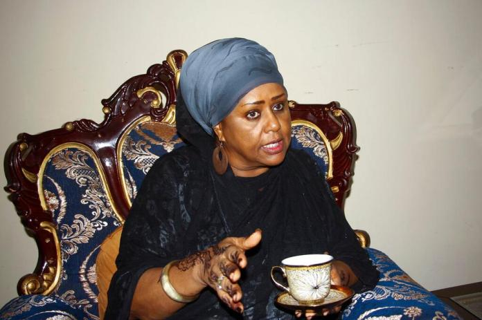 Fawzia Yusuf H. Adam discusses with guests at her home in Mogadishu, Somalia ,Saturday, July 17, 2021 (AP)