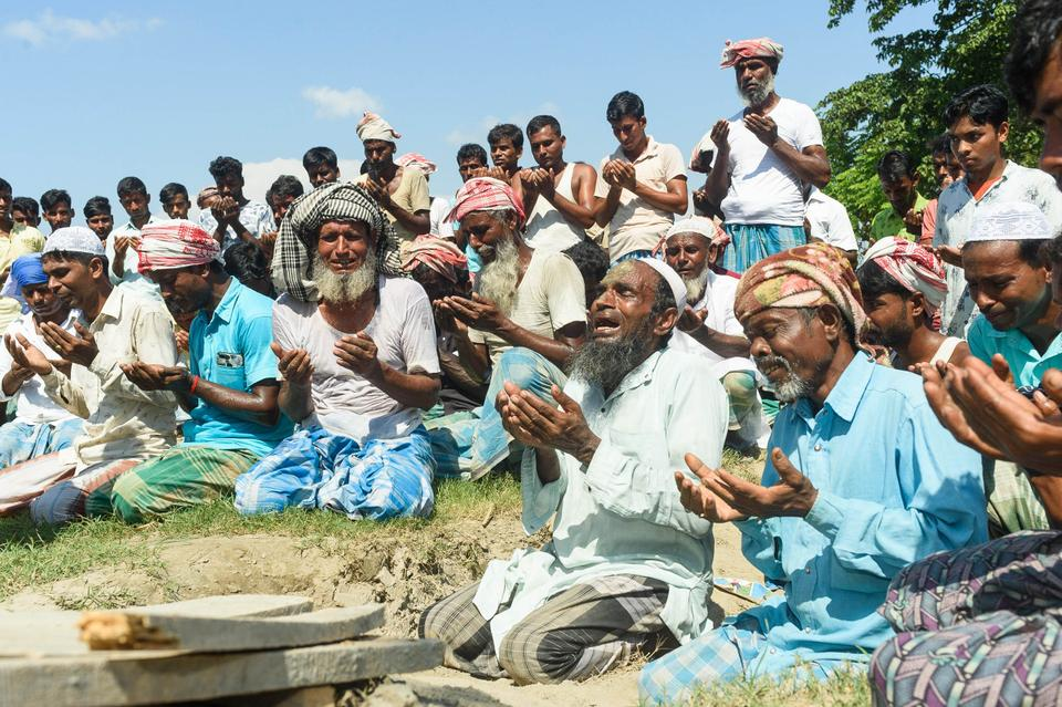 A man breaks down in a tearful wail while offering Friday prayers in the afternoon at the site of the demolished mosque in Dhalpur 3, Sipajhar, Darrang district. Despite their requests, the mosque was razed to the ground by excavators along with the homes of 800 families starting from September 20.