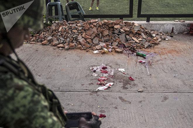 Guerrero. Militar observa una escena del crimen perpetuado por paramilitares.
