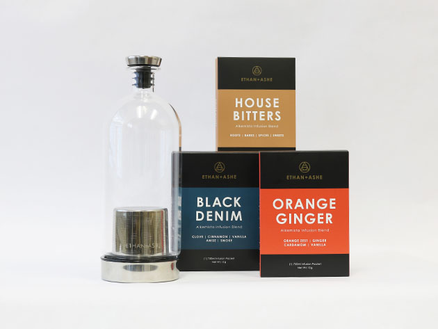 Three boxes of cocktail infusion flavors, next to a bottle