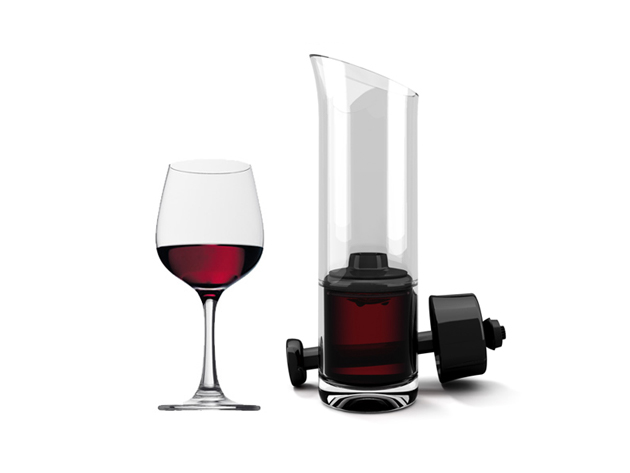 A wine glass an decanter holding red wine
