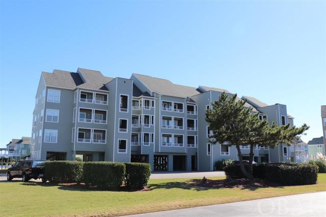"""Top Floor 2 Bedroom, 2 Bath furnished condo, vaulted ceilings, fireplace with a elevator and amazing views in the Outer Banks premier boaters community of Pirates Cove - Buccaneer Village. Open living area with Sound and canal views greet you when you walk in the door. Clear panoramic views from bedrooms. A spacious deck allows for enjoying outdoor breezes. Large storage ground floor lockup for all your beach toys. This home has been very lightly used.  A qualified boat owning buyer will have rights to a 35 ft boat dock slip for $130 a year. More than just a home, Pirates Cove is a lifestyle. """"Fishing, fun and friends"""". Enjoy access to world class fishing and water sports. Association amenities include swimming pools, clubhouse, fire pit, volleyball, basketball, pavilion picnicking shelter, fitness center, marina that has over 4 miles of docks that are fantastic for walking or running, or just kick back and watch the boats come in from your deck or relaxing at the marina restaurant. Don't have a boat? No problem charter or walk just under the bridge to the NC Wildlife water access including fishing pier, boat ramp and multiple launch sites for small craft kayaks etc. This home allows for quiet enjoyment, while being walking distance to the fun.  New HVAC with WIFI thermostat and water heater in 2017."""