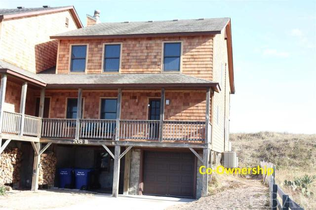 Duplex Co-ownership segment 9 in Hawks Nest 15B. Own a 1/10 co-ownership or 5 weeks in this beautiful oceanfront Nags Head home. Walk out your door on your private access to the beach and enjoy the ocean. Every year the weeks rotate so everyone can enjoy winter, fall, spring and summer in their home. Hassle free, care free living is yours because the association dues pay for all expenses - taxes, insurance and utilities. Beautiful Ocean Views. Tastefully furnished 4 bedrooms, 3 bath, laundry area, outdoor shower, grilling area and garage with storage. Decks front and back with expansive views.  What a great opportunity to vacation in an oceanfront home at a fraction of the cost. Owners may rent the weeks they choose not to enjoy themselves.  Weeks for 20120 are  May 8TH-May 15TH , Aug. 7TH-Aug 14TH, Oct.30TH-Nov6TH, Dec25TH-Jan1ST  Feb. 19TH-26TH 2021  UPDATE Brand new cedar shake siding!