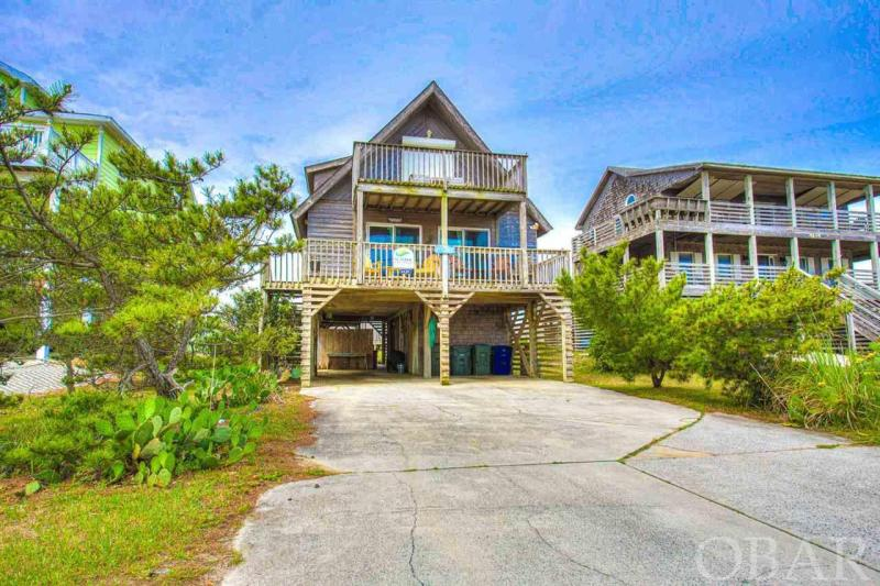 """Rare opportunity to own this Old Nags Head style home on a HUGE (12,500 sq ft) semi-oceanfront lot!  Plenty of elbow room here with lots of decking, perfect for watching sunrises, full moons over the ocean and stargazing at night.  Located in the coveted """"Nags Head Beach Cottage Row Historic District"""" with stunning ocean views, this adorable 3 bedroom 2 bath cottage generated $41,321 YTD, in its first year in a rental program!  On target to have a stellar 2021 season.  Enter 'Lady Jane' using the dry entry access into the laundry room and make your way up to the main living level.  The mid, and main, level is full of bright colors, natural lighting, and ocean views from multiple areas. The main living area is an open great room leading into fully stocked kitchen with ceramic tile floors, wood countertops, and bar seating. The perfect set up for entertaining or relaxing with family and friends. You will also find the Queen Bedroom with Full bath on this level. On to the Top Floor where you will find the the King Bedroom, Day Bedroom, and Full Bath. All with deck access to enjoy those breathtaking sunrises. Head outside to enjoy the properties large lot with private pool, soak in the hot tub, or relax on one of the many decks. 'Lady Jane' is full of modern amenities. You just can't beat a prime location, ocean views, amenities, and a beach access just 0.4 miles (a short 7 minute walk) away."""