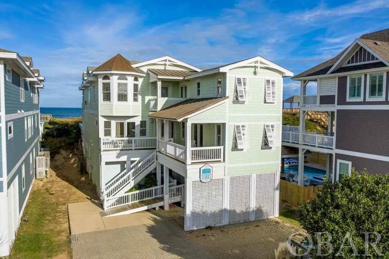 """The ultimate Nags Head beach experience awaits you in this beautiful 12-bedroom oceanfront home. """"The Stars"""" is conveniently located near shopping, restaurants, art galleries and local attractions in Nags Head. With 10 well-appointed master suites, there's no shortage of optimum privacy. On those rare rainy days, stay entertained in the recreation room on the ground-level. With a built-in kitchen with a microwave, ice maker and refrigerator, there's no need to run upstairs for a snack!  The second level features a sports bar and boasts flat screens in every corner, a sound system, billiard and foosball tables, a wet bar with a mini refrigerator, and microwave. One of the bedrooms on this floor has a shower which accommodates guests with disabilities. The shower stall is not a roll in shower; (there is a lip to go). This floor also has a deck that overlooks the ocean. The top-level living area features surround sound, gas fireplace, a wet bar and a deck that overlooks the ocean.  Also, on the top level, indulge in the grand master bath with 3 shower heads, a whirlpool bath, sound system and hand painted beach mural. The spacious gourmet kitchen featuring beautiful tile and granite countertops and top-of-the-line commercial appliances including a Sub-Zero refrigerator, Dacor Range with gas flame stove in pure convection oven, which makes cooking for large groups a breeze. Another refrigerator on the same floor to accommodate for larger groups. This house boasts one of the highest points in Nags Head, compared to other oceanfront homes. From the crow's nest you will enjoy the breathtaking panoramic views of the Atlantic Ocean, as well as views of the town of Nags Head. This deck is spacious enough for several guests to enjoy a cup of coffee with the sunrise or sunset.  Outside, you will be treated to the private pool and hot tub with a lounge deck nestled in the dune with ocean views, speakers and a private walkway to the beach. Make an offer!"""