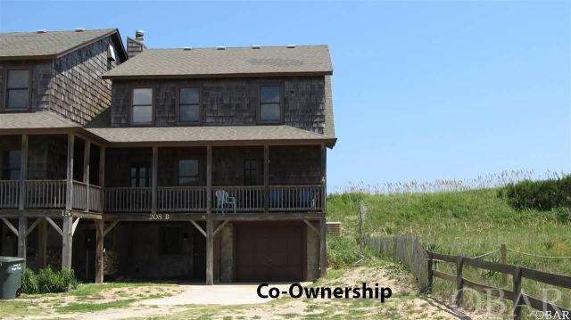 Duplex Co-ownership in Hawks Nest 15B. Own a 1/10 co-ownership or 5 weeks in this beautiful oceanfront Nags Head home. Walk out your door on your private access to the beach and enjoy the ocean. Every year the weeks rotate so everyone can enjoy winter, fall, spring and summer in their home. Hassle free, care free living is yours because the association dues pay for all expenses - taxes, insurance and utilities. Beautiful Ocean Views. Tastefully furnished 4 bedrooms, 3 bath, laundry area, outdoor shower, grilling area and garage with storage. Decks front and back with expansive views.  What a great opportunity to vacation in an oceanfront home at a fraction of the cost. Owners may rent the weeks they chose not to enjoy themselves.