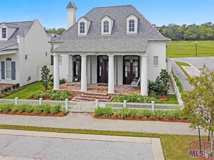 This southern style home is 'On Point' in Point-Marie! Located off River Road just west of L'Auberge casino and within minutes of LSU and downtown. Custom built in 2019, the single story home boost 12' ceilings with beautiful pine hard wood floors throughout. The kitchen contains a large center island with quartz counter tops and is open to the breakfast and living room offering an open floorplan perfect for entertaining guest. Gather around the gas and/or wood burning fireplace this fall season and enjoy football in the comfort of this perfectly appointed home. Just down the hall is a half bath, spacious utility room & pantry. Access the side patio from the master bedroom and/or hallway and enjoy the outdoors in this private setting surrounded by a brick wall. Other kitchen features include a five burner gas cooktop, pot filler, shaker style cabinetry, and elegant light fixtures. The master bath includes dual sinks, a separate shower, soaking tub, quartz counter tops and two large walk-in closets. Situated on a corner lot, this home offers great curb appeal with painted antique brick and a raised front porch. The community offers a quaint community feel with a very active social vibe, yet relaxing lifestyle. The cobblestone streets aligned with white pickets fences make you want to click your heels together and think…there's no place like home!