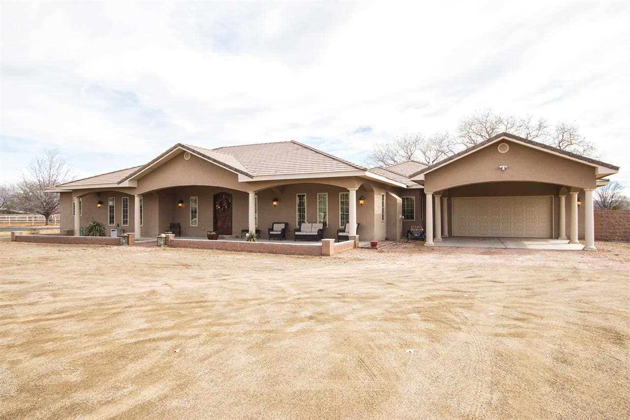 Gorgeous 4100 sq. ft., custom-built, ranch-style home, in secluded Valle Verde Estates is a must see! Nestled in Albuquerque's (SW) Valley Farms area on 1.414 acres, this home is perfect for entertaining & luxurious living.  It boasts: 2 gas fire places (LR & MB); master bedroom w/ double doors leading to private patio; in-law suite with full bath & private entry; 2 refrigerated air units; an oversized garage;large carport, covered patio; 10 foot ceilings; formal dining room w/ beam, 12 foot ceiling; 4 sky lights; 2 sinks in kitchen; breakfast nook; kitchen island; granite counter tops; pipe fencing surrounds back yard; and many more unique features.  Come see this immaculate home for yourself!